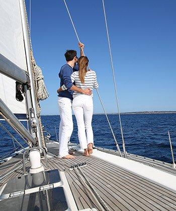 Couple on a boat on the ocean near Marblehead, MA