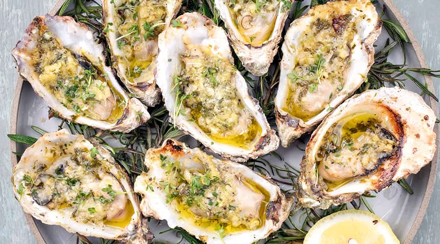 Grilled oysters with garlic butter and herb
